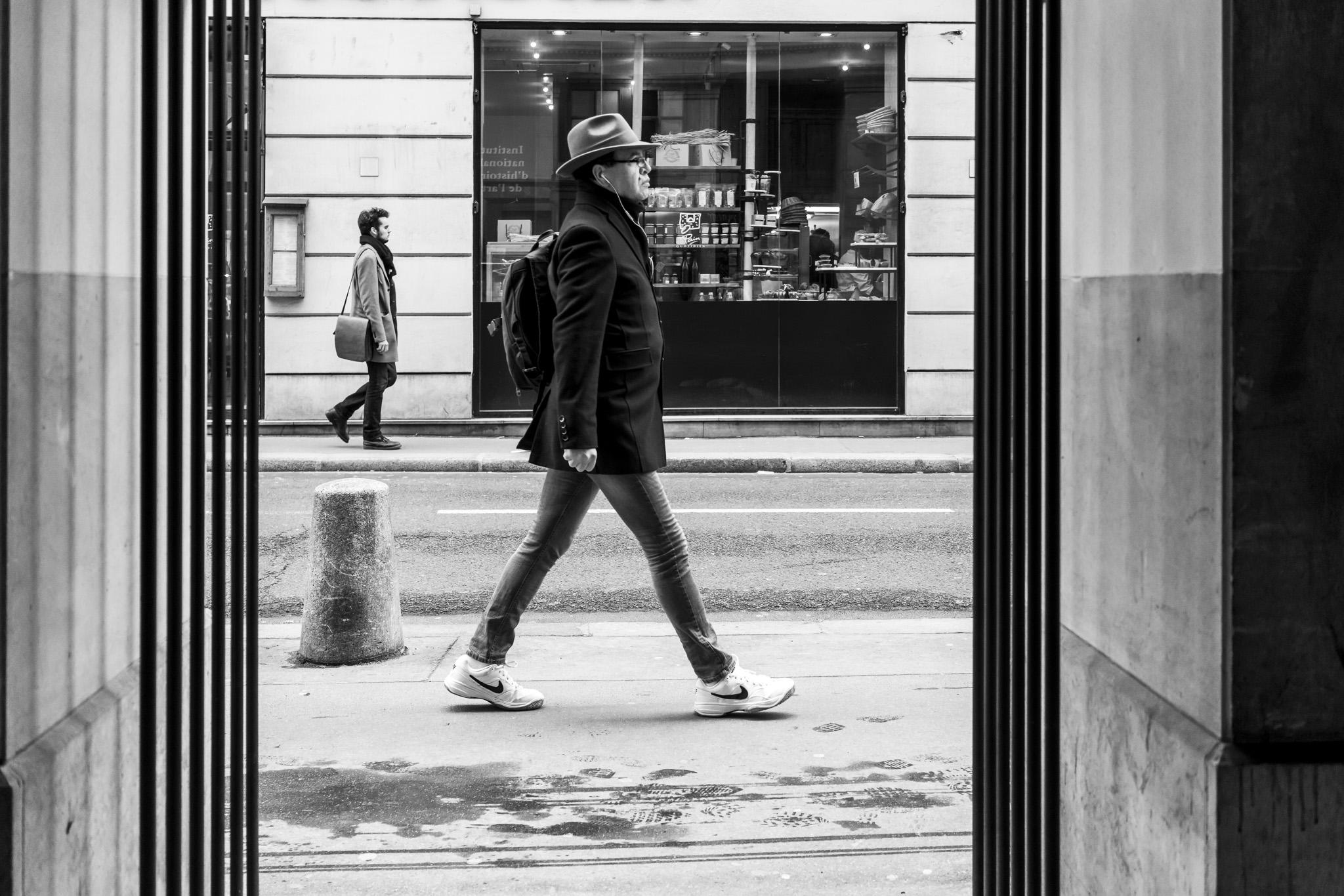 Walking past.